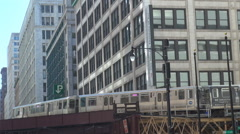 Chicago downtown metro train subway pass people commute suspended railway day US Stock Footage