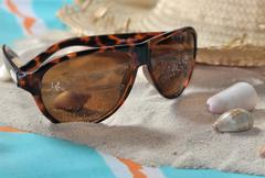 Sunglasses on the sand Stock Photos