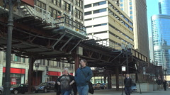 Traffic street downtown Chicago pedestrian people commute car pass metro train  Stock Footage