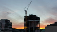 Time Lapse of Sunset Over Building Construction Site in Downtown Portland Oregon - stock footage