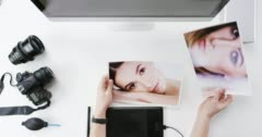 Top view photographer graphic designer chosing beauty images working at desk Stock Footage