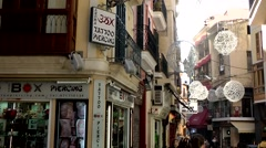 Spain Palma de Mallorca 090 old town alley with decoration in sunlight Stock Footage