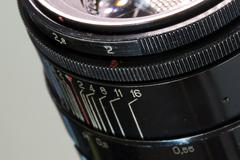 Vintage photo camera lens close up aperture 2.0 and distance scale Stock Photos