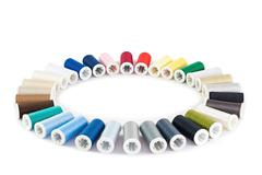 Stock Photo of Set of colorful spools of thread on white background