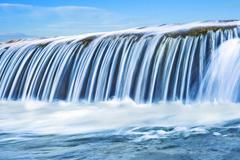 Waterfall on mountain river Stock Photos