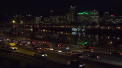 Good footage of freeway or highway traffic at night with the Portland Oregon Stock Footage