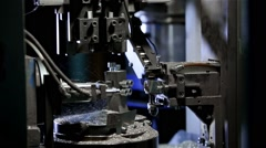The machine is handled round parts, the ball drops and charged the new part. Lat Stock Footage