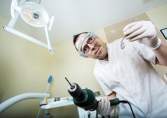 crazy dentist - stock photo
