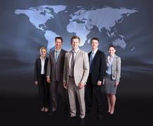 Stock Photo of Confident Business Team Standing Arms Crossed