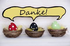 Three Colorful Easter Eggs With Comic Speech Balloon With Danke Means Thank Y - stock photo