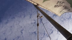 Mast with sail on background of sky, Kenya Stock Footage