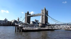 Tower Bridge with boat and jetty in London United Kingdom Stock Footage