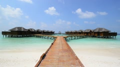 Over water bungalows with steps into amazing green lagoon Stock Footage