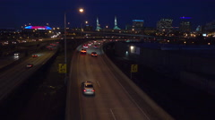 Good footage of freeway or highway traffic at night near an interchange in Stock Footage