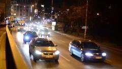 Night city - night urban street with cars - car headlight Stock Footage