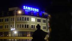 Samsung headquarters - detail of building: sign - night Stock Footage