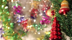 A Christmas tree decorated with a bell and an acorn with a colorful background Stock Footage