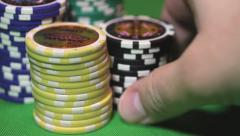 Stock Video Footage of Close up view of casino chips - somebody pushing the chips to the front