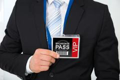 Midsection of businessman with backstage pass in office Stock Photos
