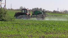 Tractor spray  crop field with pesticide insecticide herbicide chemicals Stock Footage