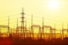 Silhouette electricity pylons during sunset - Czech Republic Stock Photos