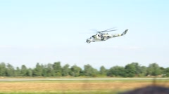 Helicopter gunship - fly over country - type Mil-Mi24 Stock Footage