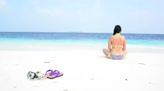 Woman is relaxing at tropical beach, South Male Atoll. Maldives - stock footage