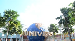 large rotating globe fountain in front of Universal Studios - stock footage