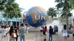 Large rotating globe fountain in front of Universal Studios Stock Footage