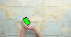Top view hands using mobile phone digital touchscreen browsing global world map - stock footage