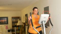 4k medium slider shot of woman on exercise machine Stock Footage
