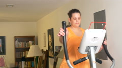 4K static shot of woman on exercise machine Stock Footage