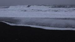 Medium Waves Hitting Black Sand Beach Stock Footage
