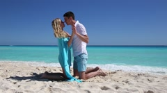 Bride and groom looking to each other and holding hands, Cancun Stock Footage