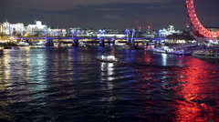 Nighttime Thames from Westminster bridge with reflected lights. Stock Footage