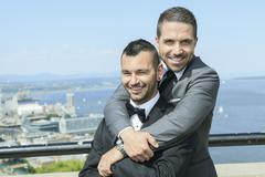 Portrait of a loving gay male couple on their wedding day - stock photo