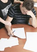 A men with financial stress at home - stock photo