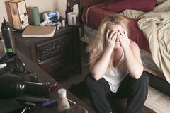 A woman inside is bedroom feel depress Stock Photos