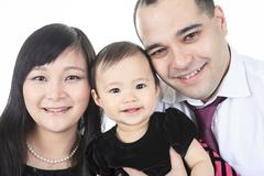 A Asian baby and family on a studio white background - stock photo