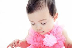A Asian baby on a studio white background Stock Photos