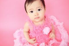 A Asian baby on a studio pink background Stock Photos