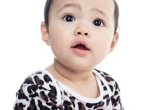 A Asian baby on a studio white background - stock photo