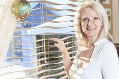A Simple Senior Portrait in kitchen in front of window - stock photo