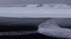 Foamy Waves Crash into Black sand beach Stock Footage