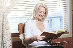 Portrait of a Senior person look at a photo album - stock photo