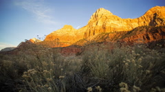 Timelapse of sunset lighting up the cliff face in zion national park. Stock Footage