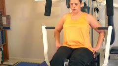 4K pan up of woman doing leg lift exercises Stock Footage