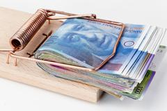 Swiss franc in mousetrap Stock Photos