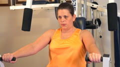 4K woman doing bench press on exercise machine. Stock Footage