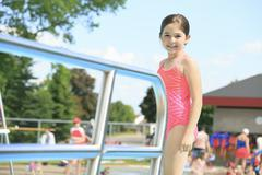 Child play at the pool place in a beautifull summer - stock photo